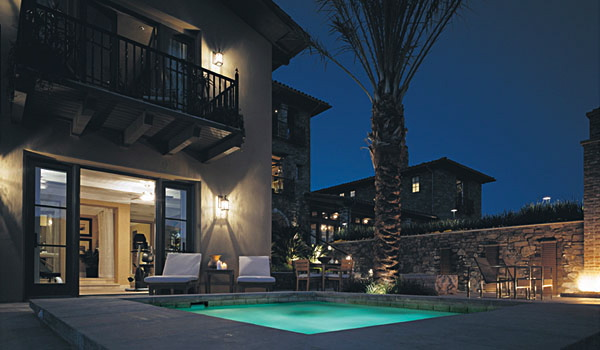 Lutron lighting and automated shading for backyard luxury house